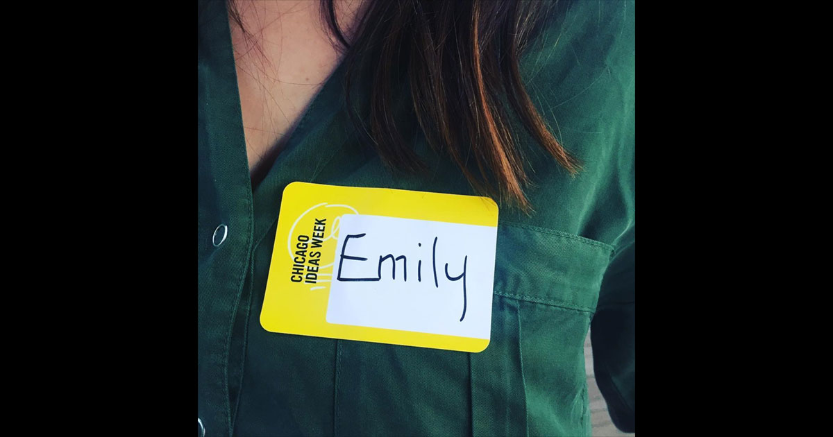 Name tag example, pulled from @hellomypodcast: bright yellow name tag sticker with event name printed and handwritten guest name
