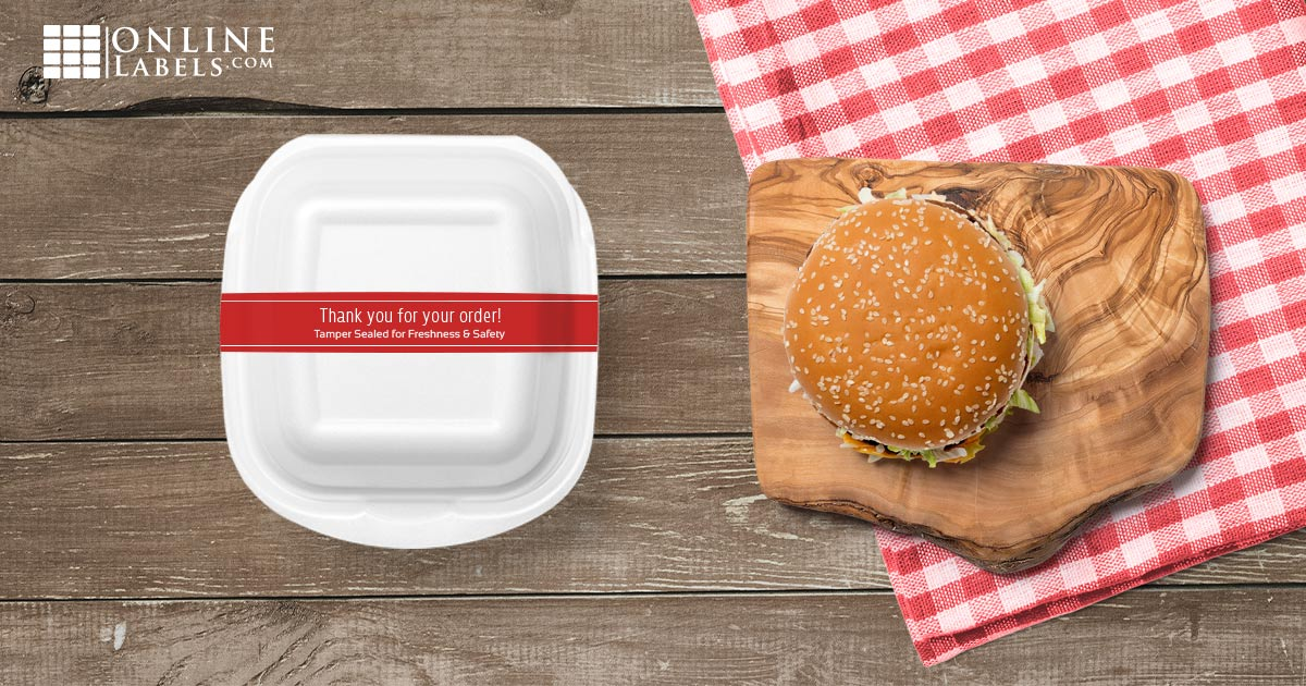 A full-wrap label around to-go food container to preventing it from opening in transit or being opened by a delivery driver