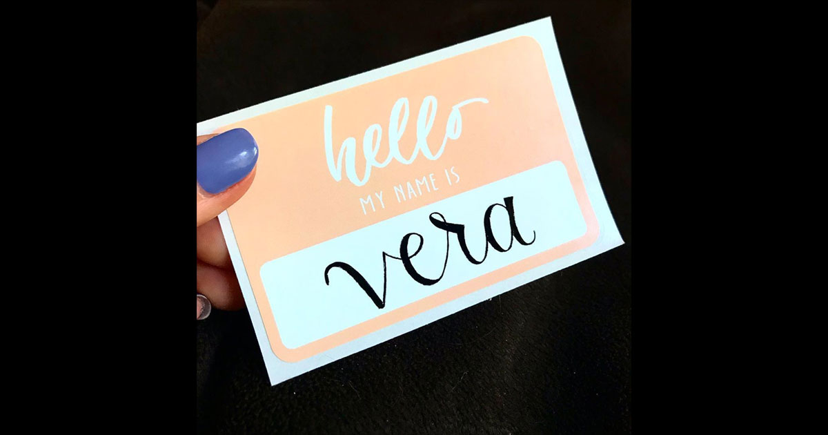"Name tag example, pulled from @moonlitdesignco: simple, ""hello my name is"" name tag sticker in pastel pink/salmon with calligraphic name"