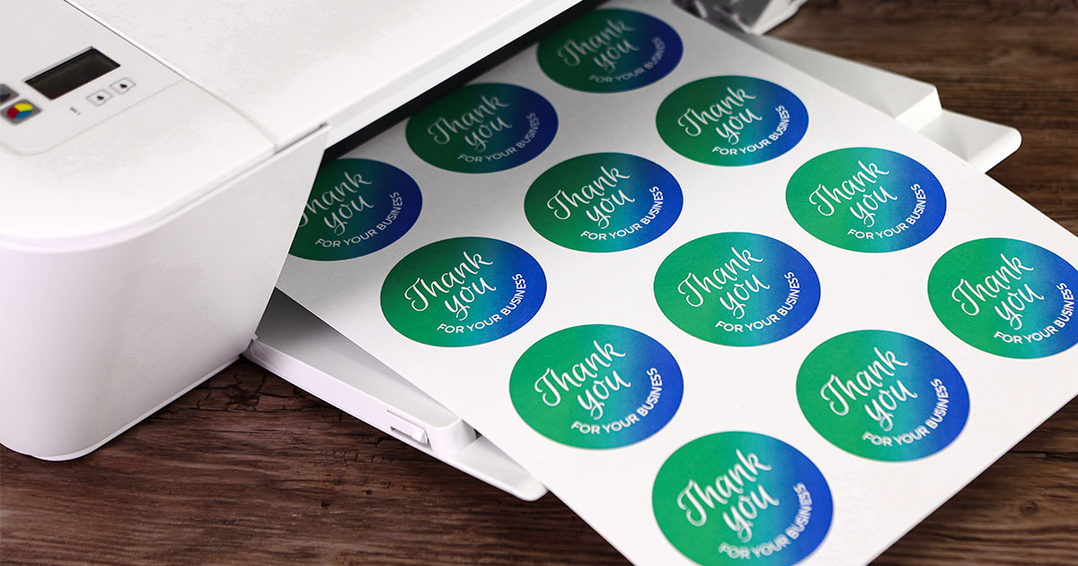 Printed sticker sheets in printer.