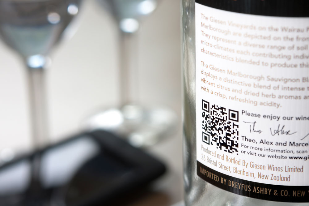 Wine bottle with QR code printed on label