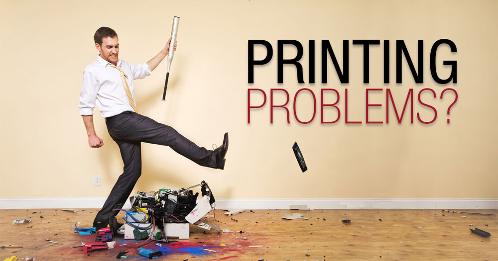 Man kicking printer - common fixes for printing problems when using labels